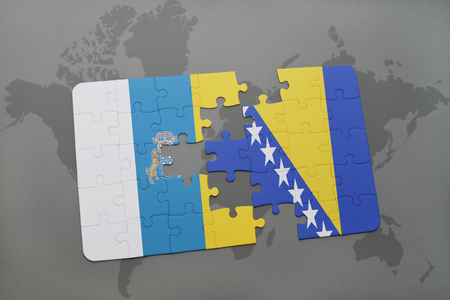 canary: puzzle with the national flag of canary islands and bosnia and herzegovina on a world map background. 3D illustration Stock Photo