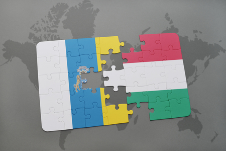 canary: puzzle with the national flag of canary islands and hungary on a world map background. 3D illustration