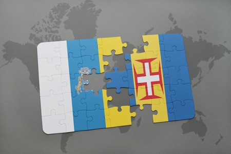 canary islands: puzzle with the national flag of canary islands and madeira on a world map background. 3D illustration