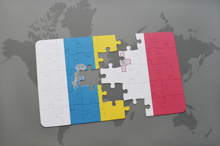 puzzle with the national flag of canary islands and malta on a world map background. 3D illustration