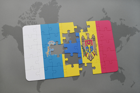 canary: puzzle with the national flag of canary islands and moldova on a world map background. 3D illustration Stock Photo