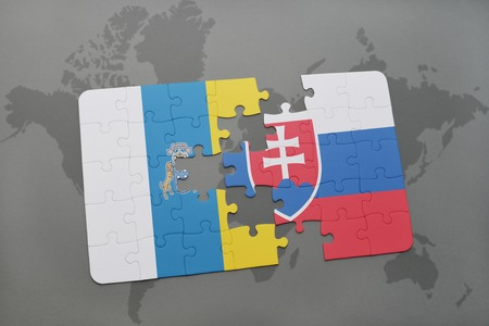 canary: puzzle with the national flag of canary islands and slovakia on a world map background. 3D illustration Stock Photo