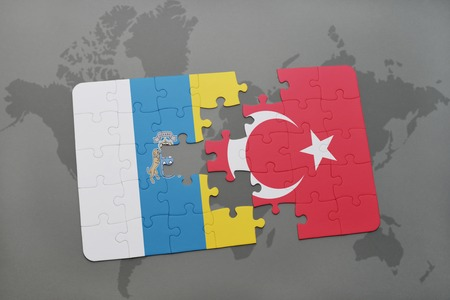 canary: puzzle with the national flag of canary islands and turkey on a world map background. 3D illustration Stock Photo