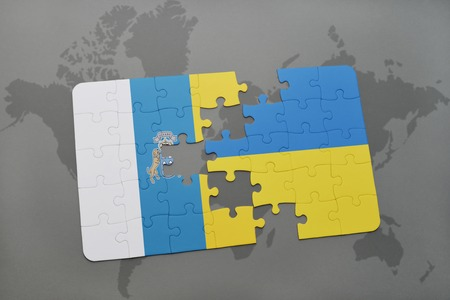 canary islands: puzzle with the national flag of canary islands and ukraine on a world map background. 3D illustration