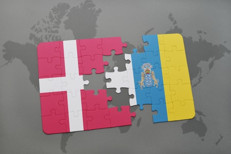 canary: puzzle with the national flag of denmark and canary islands on a world map background. 3D illustration Stock Photo