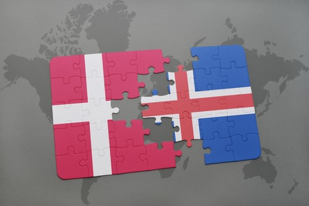the icelandic flag: puzzle with the national flag of denmark and iceland on a world map background. 3D illustration