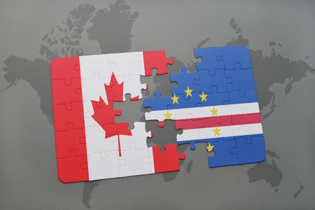 praia: puzzle with the national flag of canada and cape verde on a world map background. 3D illustration