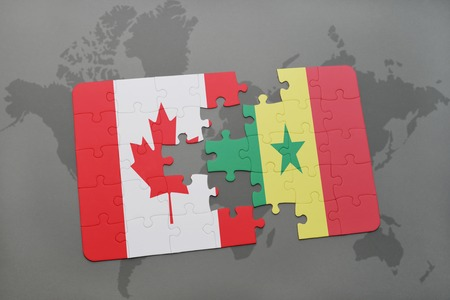 dakar: puzzle with the national flag of canada and senegal on a world map background. 3D illustration Stock Photo