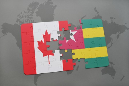 togo: puzzle with the national flag of canada and togo on a world map background. 3D illustration