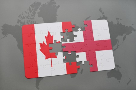 banderas america: puzzle with the national flag of canada and england on a world map background. 3D illustration