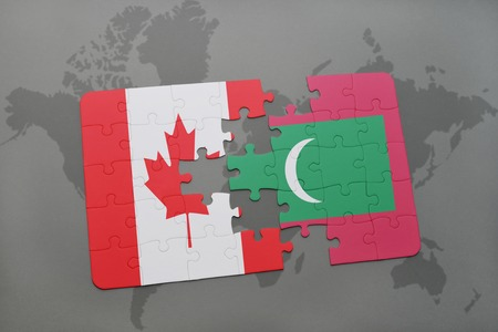 maldives island: puzzle with the national flag of canada and maldives on a world map background. 3D illustration Stock Photo