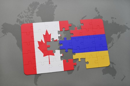 armenian: puzzle with the national flag of canada and armenia on a world map background. 3D illustration