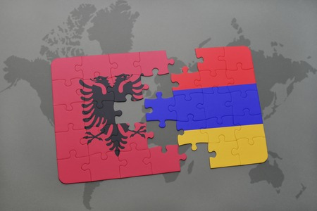 yerevan: puzzle with the national flag of albania and armenia on a world map background. 3D illustration Stock Photo