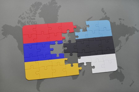 armenian: puzzle with the national flag of armenia and estonia on a world map background. 3D illustration