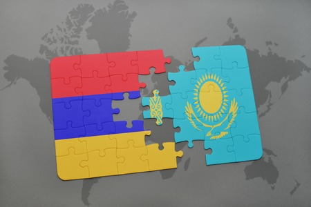 yerevan: puzzle with the national flag of armenia and kazakhstan on a world map background. 3D illustration