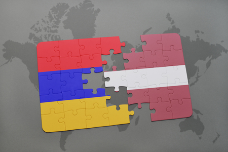 puzzle with the national flag of armenia and latvia on a world map background. 3D illustration Stock Photo