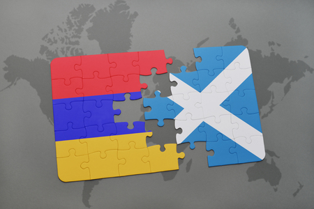 armenian: puzzle with the national flag of armenia and scotland on a world map background. 3D illustration
