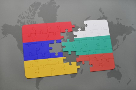 armenia: puzzle with the national flag of armenia and bulgaria on a world map background. 3D illustration