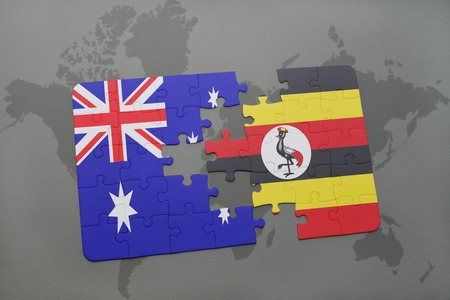 kampala: puzzle with the national flag of australia and uganda on a world map background. 3D illustration