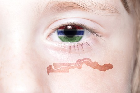 humans face with national flag and map of gambia. concept