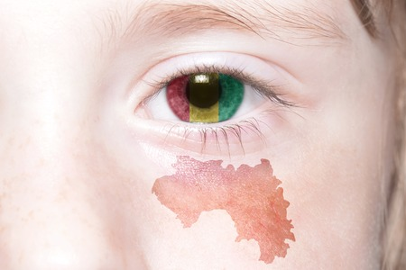 humans face with national flag and map of guinea. concept