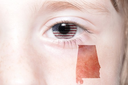 alabama state: humans face with national flag of united states of america and alabama state map. concept Stock Photo