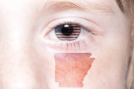 humans face with national flag of united states of america and arkansas state map. concept