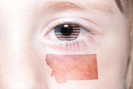 humans face with national flag of united states of america and montana state map. concept