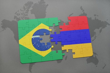 yerevan: puzzle with the national flag of brazil and armenia on a world map background. 3D illustration Stock Photo