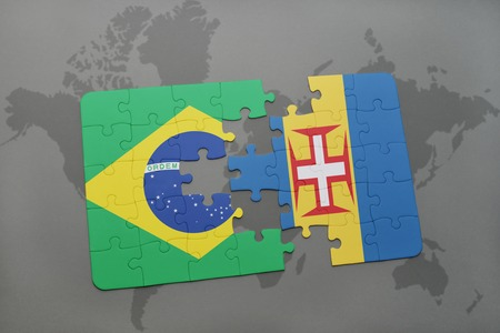madeira: puzzle with the national flag of brazil and madeira on a world map background. 3D illustration