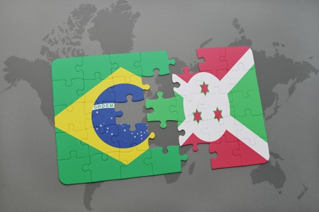 puzzle with the national flag of brazil and burundi on a world map background. 3D illustration Stock Photo