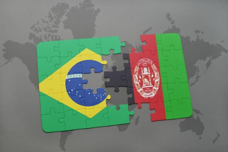 afghan: puzzle with the national flag of brazil and afghanistan on a world map background. 3D illustration Stock Photo