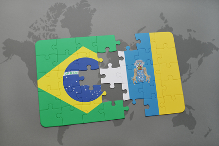 canary: puzzle with the national flag of brazil and canary islands on a world map background. 3D illustration