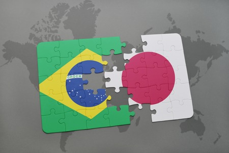 middle east conflict: puzzle with the national flag of brazil and japan on a world map background. 3D illustration Stock Photo