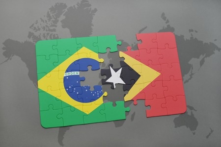 timor: puzzle with the national flag of brazil and east timor on a world map background. 3D illustration Stock Photo