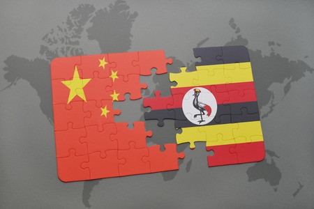 kampala: puzzle with the national flag of china and uganda on a world map background. 3D illustration Stock Photo