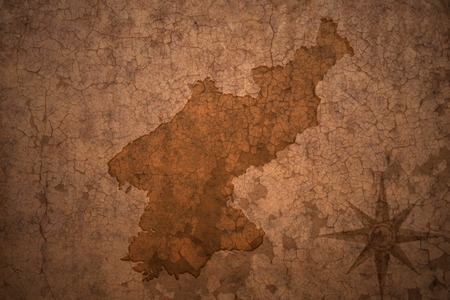 north korea map on a old vintage crack paper background