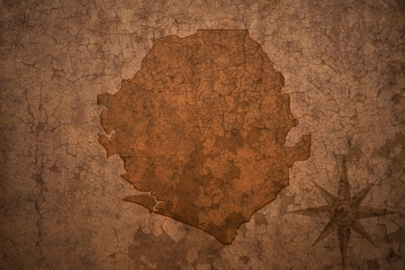 sierra leone: sierra leone map on a old vintage crack paper background