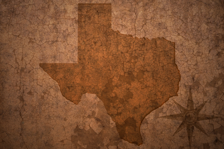 texas state map on a old vintage crack paper background