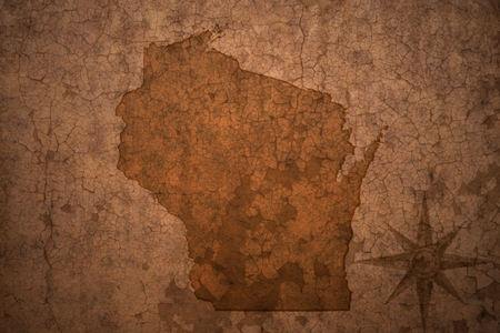 wisconsin state: wisconsin state map on a old vintage crack paper background