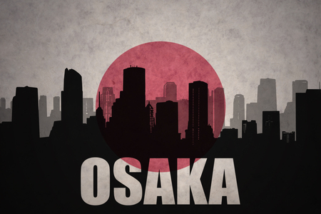 clash: abstract silhouette of the city with text Osaka at the vintage japanese flag background