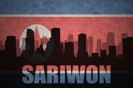 clash: abstract silhouette of the city with text Sariwon at the vintage north korea flag background