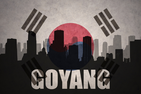 clash: abstract silhouette of the city with text Goyang at the vintage south korea flag background