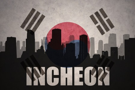 incheon: abstract silhouette of the city with text Incheon at the vintage south korea flag background Stock Photo