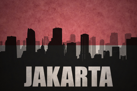 jakarta: abstract silhouette of the city with text jakarta at the vintage indonesian flag background
