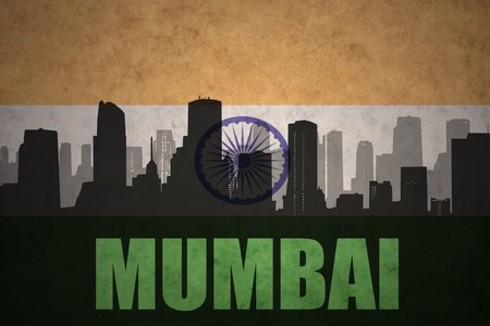 mumbai: abstract silhouette of the city with text Mumbai at the vintage indian flag background