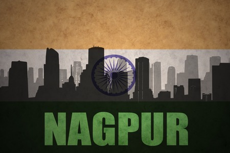 nagpur: abstract silhouette of the city with text Nagpur at the vintage indian flag background Stock Photo