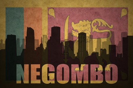 ceylon: abstract silhouette of the city with text Negombo at the vintage sri lanka flag background