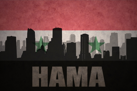 syrian: abstract silhouette of the city with text Hama at the vintage syrian flag background Stock Photo
