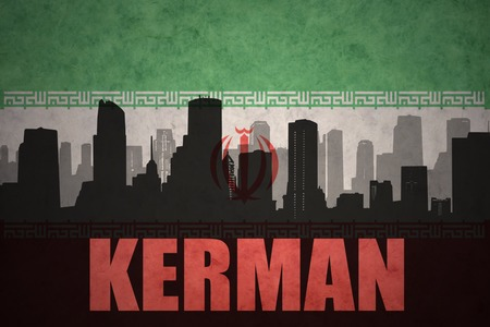 iranian: abstract silhouette of the city with text Kerman at the vintage iranian flag background